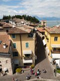 View of colorful old buildings in Sirmione and Lake Garda from Scaliger castle wall, Stock Photo