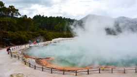 Wai-O-Tapu Thermal Wonderland New Zealand. View of colorful steaming volcanic Champagne pool in geothermal Wai-O-Tapu wonderland in Rotorua, North Island, New stock photography