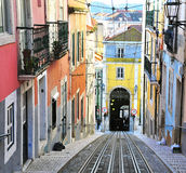 View of the colorful street with rails in Lisbon Royalty Free Stock Photo