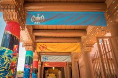 Colorful walkway in Santa Fe New Mexico. View of a colorful walkway with artsy columns in the plaza in downtown Santa Fe New Mexico Royalty Free Stock Photos