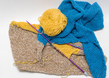 View of colorful yarn and needles cotton knitting craft on grey Royalty Free Stock Images