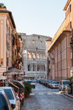 View of Colosseum building through street in Rome. ROME, ITALY - OCTOBER 31, 2016: view of Colosseum building through street Via di San Giovanni in Laterano Royalty Free Stock Photo