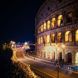 View of the Colosseum by night in Rome, Italy. Night scene near Colosseum anfitheatre stock photography