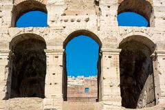 View of the colosseum in rome. On blue sky background stock photo