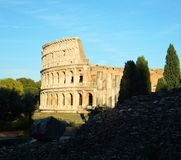 View of the Colosseum in Rome, Italy on a bright sunny day against blue sky royalty free stock images