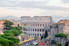View of the Colosseum. ROME, ITALY - 1 December 2015: View of the Colosseum and some othe ancient buildings being consolidated with lots of visitors around in Royalty Free Stock Image