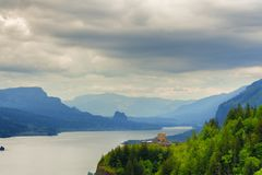 View of the Columbia River Gorge and Crown Point. The view from a rest area along the Historic Columbia River Highway of Columbia River Gorge with Vista house Stock Photo