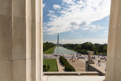 The view through the columns of the Lincoln Memorial to the Monu. Ment and the Capitol Building in Washington DC Stock Image