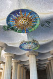 View of the columns and mosaic ceiling Park Guell. View of the columns and mosaic ceiling. Architectural landmark designed by the famous architect Antonio Gaudi Royalty Free Stock Photography