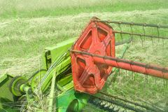 View from the combine harvester cabin during harvesting Royalty Free Stock Images