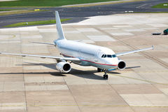 View of commercial airplane. Parking at an airport Stock Images