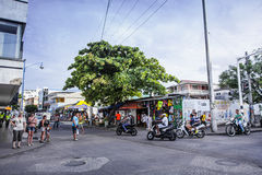 View of a Commercial Intersection in San Andres, Colombia. Editorial - San Andres, Colombia, January 2014. San Andrés is a coral island in the Caribbean Sea Stock Image