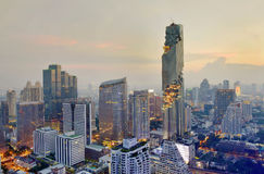 View commercial modern building and condominium in city downtown with Mahanakorn building. At night skyline, Bangkok Thailand stock image