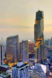 View commercial modern building and condominium in city downtown with Mahanakorn building. At night skyline, Bangkok Thailand stock photography