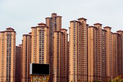 Commercial residential buildings under cloudy sky. A view of commercial residential buildings under overcast sky stock images