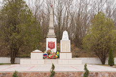 A view of the common grave of Soviet soldiers and civilians in the village of Sukko, who died figh. Sukko, Russia - March 15, 2016: A view of the common grave of Stock Images