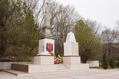 A view of the common grave of Soviet soldiers and civilians in the village of Sukko, who died figh. Sukko, Russia - March 15, 2016: A view of the common grave of Royalty Free Stock Photos