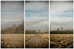 View of the communications tower and road to the forest. Against a blue sky with white clouds Royalty Free Stock Photos