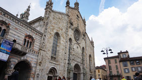 View of Como Cathedral, cattedrale di Santa Maria Assunta, Gothic cathedral with rococo cupola with tourists, Como, Italy. COMO, ITALY - MAY 14, 2017 - side view Royalty Free Stock Photo