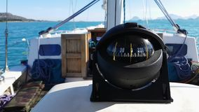 View of compass on yacht dashboard. Moving straight to North. View of modern black compass on yacht dashboard. Moving straight to North stock video