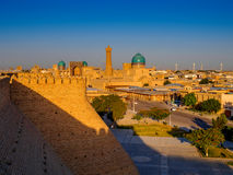 View of the complex Poi-Kolon with the Ark fortress at sunset, Bukhara, Uzbekistan. UNESCO world Heritage Stock Images