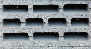 Concrete cinder block, side view. View on concrete cinder block, side view stock photography