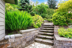 View of concrete stairs to garden at backyard. Nice landscape desing around the house. View of concrete stairs to garden at backyard.Northwest, USA Stock Images