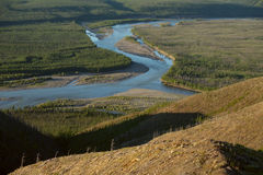 The view on the confluence of two rivers. The river Mомa end Erikit. Yakutia. Russia stock images