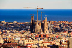 View of the construction Sagrada Familia and over the sea of houses in Barcelona. With approx. 1.6 million inhabitants, Barcelona Stock Photography