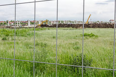 View on the construction site through a fence wire stock photography