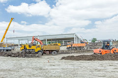 View on construction site with machinery, unfinished modern edif Stock Photo