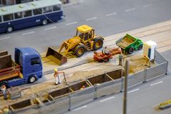 View of construction site of mini toy workers and vehicle royalty free stock images