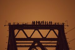 View of constructors on bridge beam stock photography