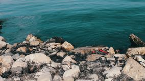 View of a contaminated Caspian Sea. Trash and rubbish on sand of seashore on sea background. Environmental problem on. View of the contaminated Caspian Sea stock footage