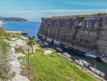 View of the Contrafossa channel in the city of Corfu. View of the Contrafossa canal that separates the city of Corfu or Kerkyra from the old defensive fortress Royalty Free Stock Photo