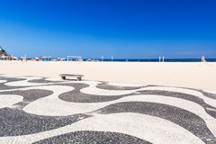 View of Copacabana beach with mosaic of sidewalk in Rio de Janeiro Royalty Free Stock Photos