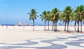 View of Copacabana beach with palms and mosaic of Royalty Free Stock Image