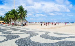 View of Copacabana beach with palms mosaic of sidewalk in Rio de Janeiro Royalty Free Stock Photos