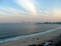 View of Copacabana beach in  Rio de Janeiro, Brazil. View of Copacabana beach in Rio de Janeiro Brazil - landscape at sunset Stock Photo