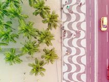 View of Copacabana boardwalk during late afternoon, taken with a drone, with the famous portuguese stone texture . Rio de Janeiro,. View of Copacabana beachs stock photo