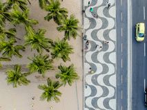 View of Copacabana boardwalk during late afternoon, taken with a drone, with the famous portuguese stone texture . Rio de Janeiro,. View of Copacabana beachs stock image