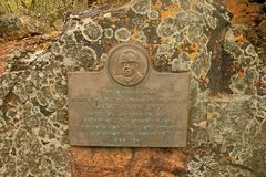 MEMORIAL PLAQUE IN PRETORIA BOTANICAL GARDENS. View of a copper plaque in honour of the founder of the Pretoria Botanical Gardens Royalty Free Stock Photo