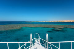 View at the coral sea from white yacht. Perfect place for snorkeling. Summer vacation royalty free stock photography