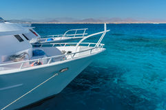 View at the coral sea and white yacht. Perfect place for snorkeling. Summer vacation at sea. With turquoise clear water stock photography