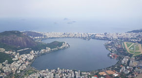 View from Corcovado in Rio de Janeiro. Brazil with the statue of Christ the Redeemer a top Stock Photography