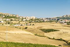 View of Corleone between fields in Sicily, Italy. View of Corleone between fields, a town known for associating with the mafia in Sicily, Italy Royalty Free Stock Photo