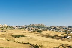 View of Corleone between fields in Sicily, Italy. View of Corleone between fields, a town known for associating with the mafia in Sicily, Italy Royalty Free Stock Image