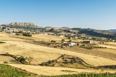 View of Corleone between fields in Sicily, Italy. View of Corleone between fields, a town known for associating with the mafia in Sicily, Italy Royalty Free Stock Photos