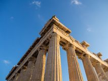 View of corner of Parthenon and its columns on Acropolis, Athens, Greece against blue sky royalty free stock images