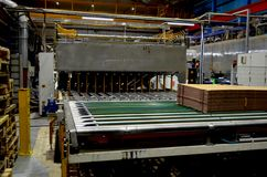 Corrugated cardboard production line. View of corrugated cardboard production line at the plant stock image